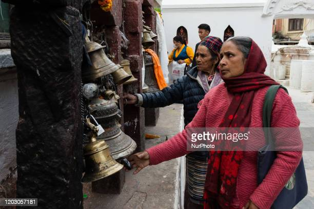 Nepali women ring bells at the Boudhanath stupa on the first day of the Tibetan New Year celebrations on 24 February, 2020 in Kathmandu, Nepal. The...