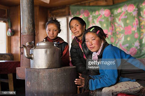 nepali young girl warming up hands in the lodge, himalaya - solu khumbu stock pictures, royalty-free photos & images