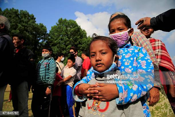 Nepalis are seen around the tents at an empty land in Katmandu, Nepal on April 30, 2015. The death toll in Nepal following the devastating...