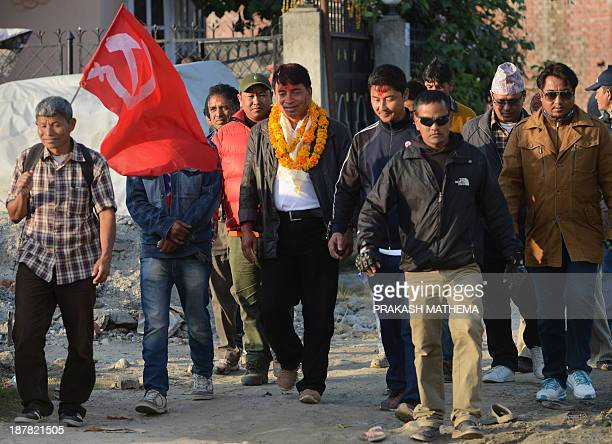 NepalpoliticselectionMaoistFOCUS by Ammu Kannampilly Unified Communist Party of Nepal leader Nanda Kishor Pun walks with supporters during a door to...