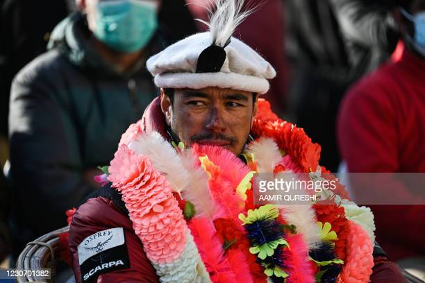 Nepal's climber Nirmal Purja delivers a speech upon his arrival for a welcome ceremony after becoming with his team, the firsts to summit Pakistan's...