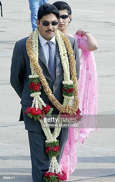 Nepal's Crown Prince Paras Bir Bikram Shah Dev and Princess Himani Rajyalakshmi Dev walk towards their car after their arrival in Bangalore 25...