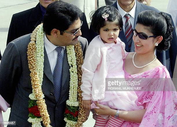 Nepal's Crown Prince Paras Bir Bikram Shah Dev speaks with his daughter Purnika and Princess Himani Rajyalakshmi Dev as they walk towards their car...