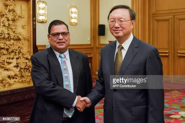 Nepal's Deputy Prime Minister Krishna Bahadur Mahara shakes hands with Chinese State Councillor Yang Jiechi prior to their meeting at the Zhongnanhai...