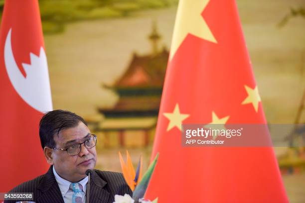 Nepal's Deputy Prime Minister Krishna Bahadur Mahara speaks during a press conference following his meeting with the Chinese foreign minister at the...