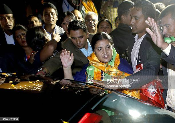 Nepal's first elected woman president Bidhya Bhandari waves after she is elected as New President of Nepal at the parliament in Kathmandu Nepal 28...