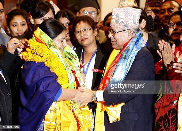 Nepal's first female president Bidhya Bhandari is congratulated by former Prime Minister Madhav Kumar Nepal after she is elected as New President of...