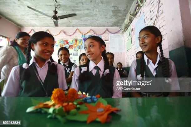 Nepal's former living goddess or Kumari Matina Shakya sits in a classroom on her first day of school in Kathmandu on October 9 2017 Matina Shakya was...