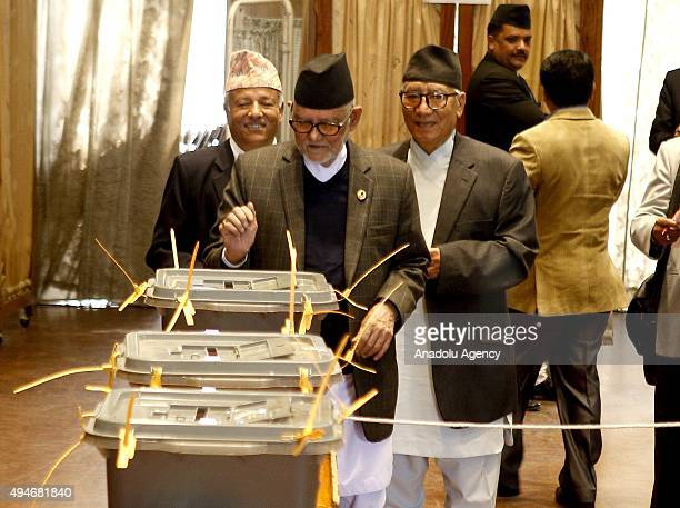 Nepal's former prime minister and chairman of Nepali Congress party Sushil Koirala casts his vote during Nepal's presidential election at the...