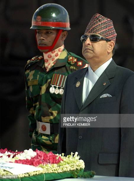 Nepal's King Gyanendra is flanked by a Bangladeshi soldier after laying a wreath at The Mazar of Shaheed President Ziaur Rahman memorial in Dhaka 12...