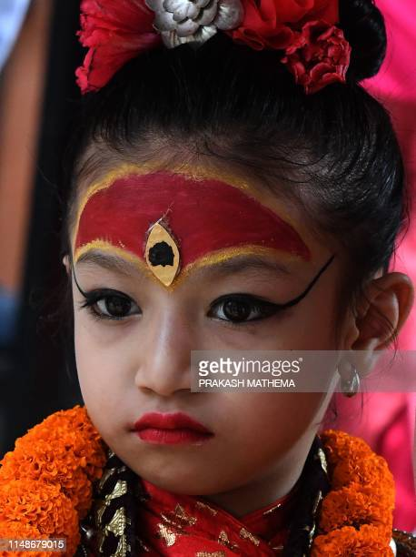 Nepal's Living Goddess also called the 'Kumari' looks on in Patan in the outskirts of Kathmandu on June 9 2019 The Kumari considered a living goddess...