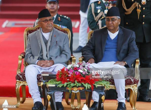 Nepal's new Prime Minister Khadga Prasad Oli also known as KP Sharma Oli and outgoing Prime Minister Sher Bahadur Deuba look on during the swearingin...
