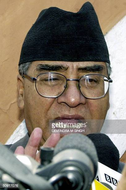 Nepal's new Prime Minister Sher Bahadur Deuba gestures as he addresses media representatives in Kathmandu 02 June 2004 after being reappointed Prime...