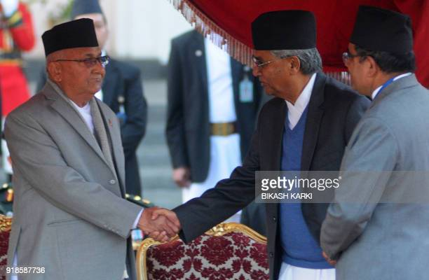 Nepal's newlyelected Prime Minister KP Sharma Oli shake hands with outgoing prime minister Sher Bahadur Deuba after swearingin ceremony on at the...