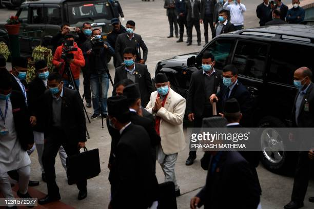 Nepal's Prime Minister KP Sharma Oli arrives to attend the first meeting of the House of Representatives convened after the Supreme Court reinstated...