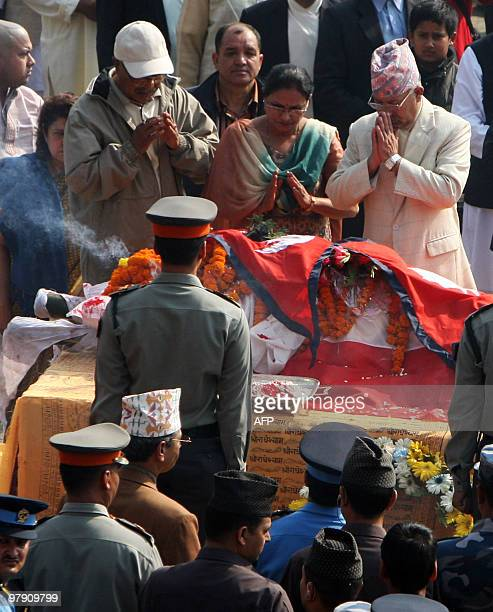 Nepal's Prime Minister Madhav Kumar Nepal and his wife pay their last respect to Nepali Congress president and former prime minister Girija Prasad...