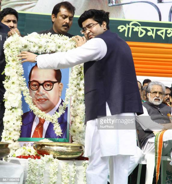 MP nephew of Bengal Chief Minister Mamata Banerjee garland and pray tribute to Dr B R Ambedkar Photographs at the part of Trinamool Congress observe...