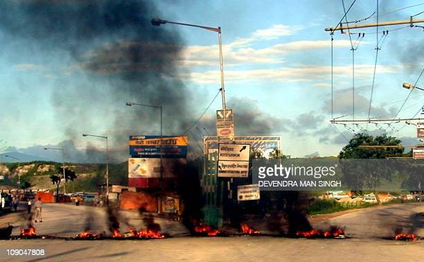 Nepleses demonstrators burn tyres in Kathmandu 04 June 2001 as police crack down on tens of thousand of people protesting against the new king and...