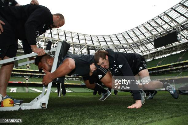 Nepo Laulala and Brodie Retallick of the New Zealand All Blacks on the scrum machine during the All Black captains run at AVIVA Stadium on November...