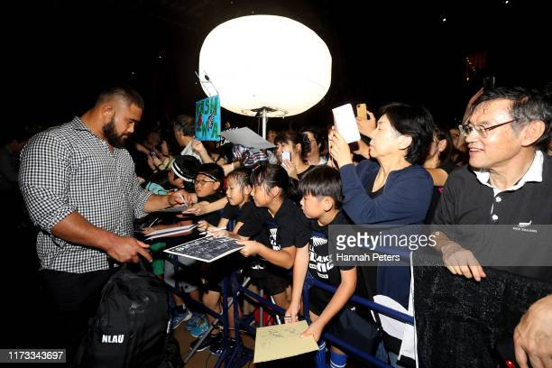 Nepo Laulala of the All Blacks signs autographs for fans after arriving to their hotel on September 09, 2019 in Kashiwa, Chiba, Japan.