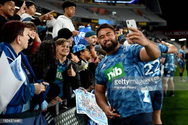 Nepo Laulala of the Blues celebrates with fans after winning the Super Rugby Trans-Tasman Final match between the Blues and the Highlanders at Eden...