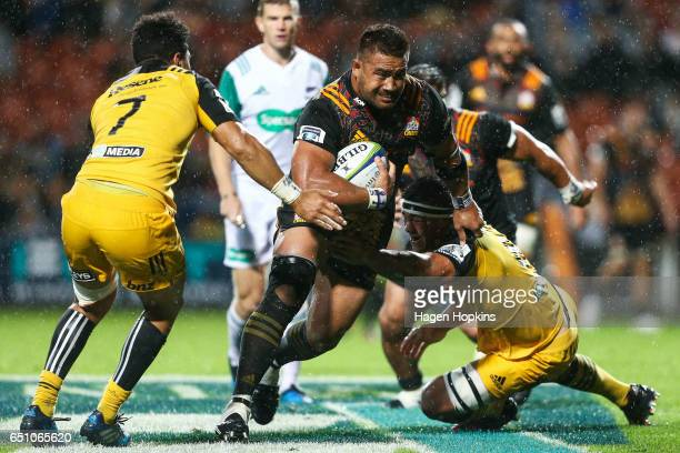 Nepo Laulala of the Chiefs is tackled during the round three Super Rugby match between the Chiefs and the Hurricanes at FMG Stadium Waikato on March...