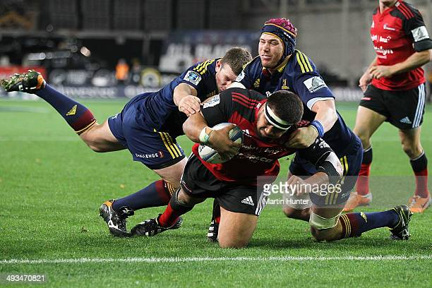 Nepo Laulala of the Crusaders dives over to score a try during the round 15 Super Rugby match between the Highlanders and the Crusaders at Forsyth...