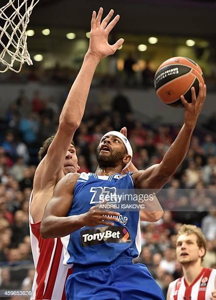 Neptunas Klaipeda's US forward Mustafa Shakur vies with Red Star Belgrade's centre Boban Marjanovic during the Euroleague basketball match between...