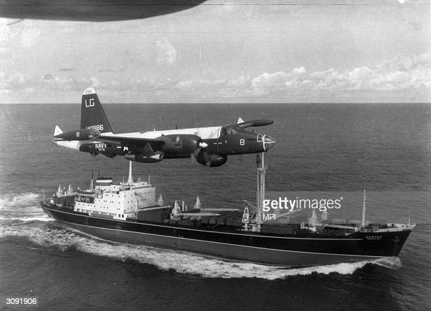 Neptune US patrol plane flying over a Soviet freighter during the Cuban missile crisis.