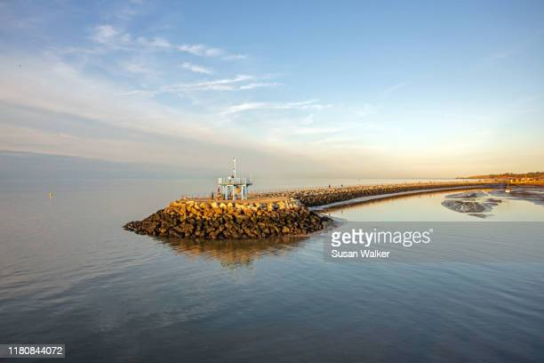 neptune's arm (breakwater) herne bay - construction barrier stock pictures, royalty-free photos & images