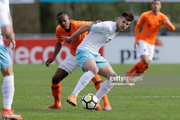 Neraysho Kasanwirjo of Holland U17 Romen Hanzis of Israel U17 during the match between Holland U17 v Israel U17 at the Sportpark Zegersloot on March...