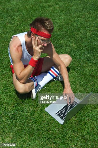 Nerd Athlete Consults Laptop Computer on Field