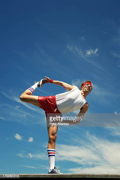 Nerd Athlete Stretches Against Blue Sky