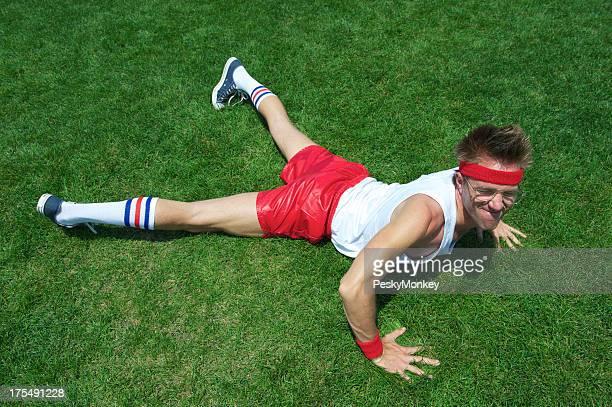 Nerd Athlete Struggles Doing Pushup in Green Grass