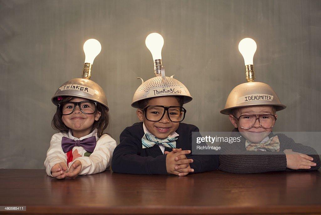 Nerd Children Wearing Lighted Mind Reading Helmets : Stock Photo