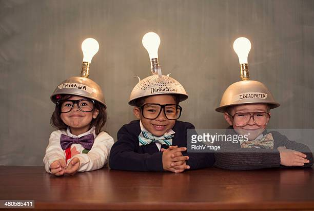nerd children wearing lighted mind reading helmets - three people stock pictures, royalty-free photos & images