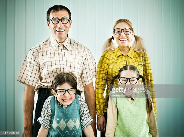 nerd family standing shyly and looking at the camera. - girl nerd hairstyles stock photos and pictures