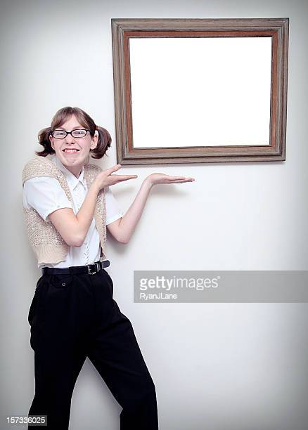 nerd girl with blank picture frame - girl nerd hairstyles stock photos and pictures
