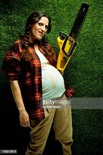 Nerd pregnant lumberjack holding a chainsaw