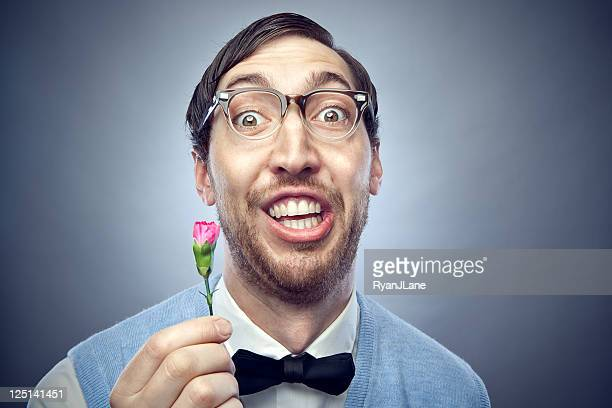 nerd student giving flower - nerd stock pictures, royalty-free photos & images