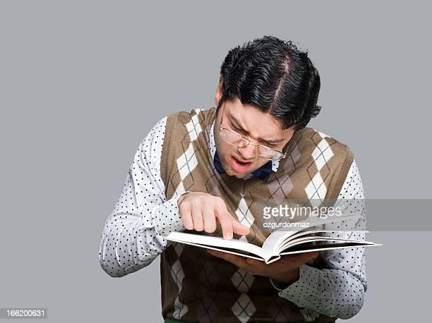 Nerd student reading a book