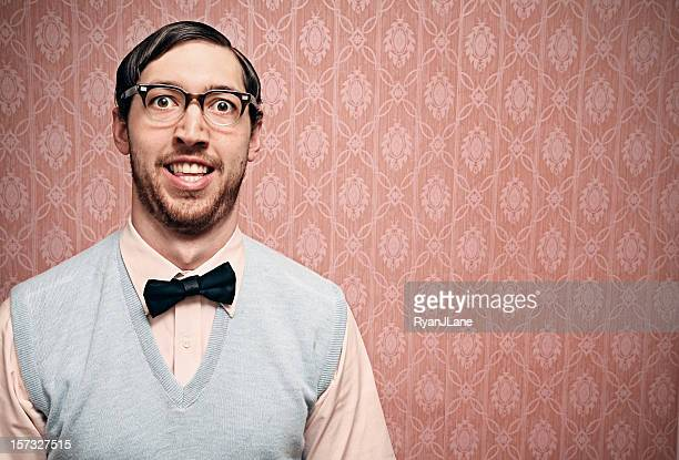 nerd student with retro glasses and pink wallpaper - nerd stock pictures, royalty-free photos & images