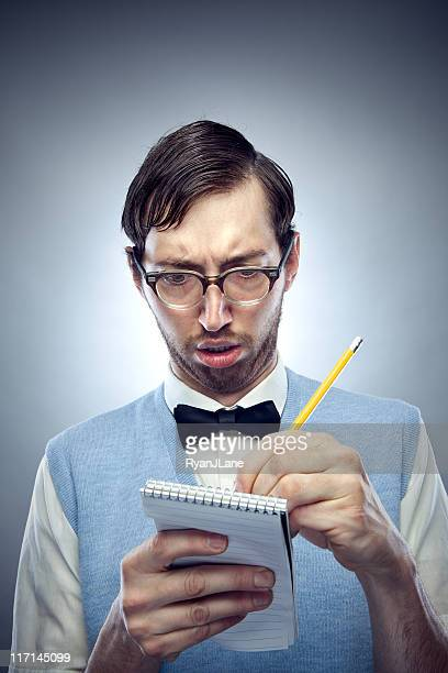 Nerd Student Writing in Notepad with Pencil