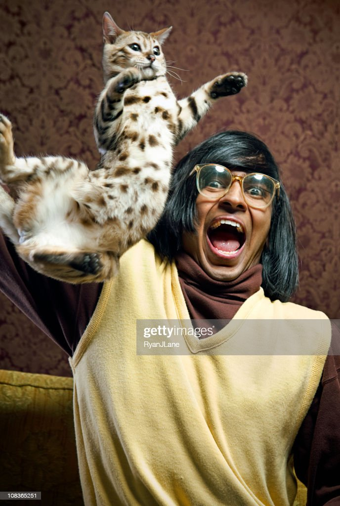 Nerd With His Flying Cat : Stock Photo