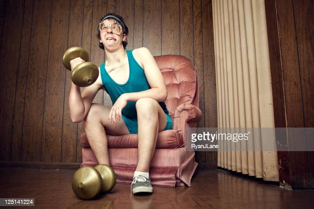 Nerd Young Man Exercising with Weights
