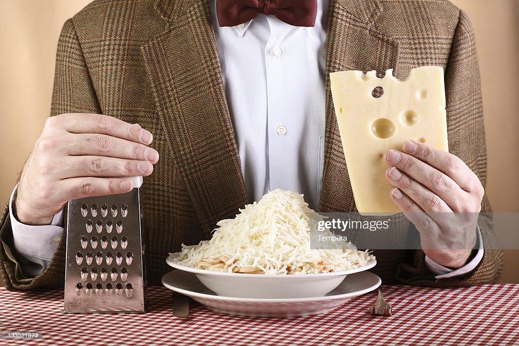 Nerdish cheese lover on brown background _ horizontal : Stock Photo