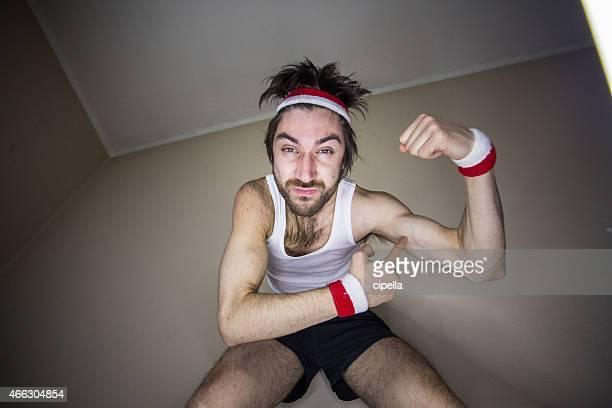Nerdy boy showing muscle