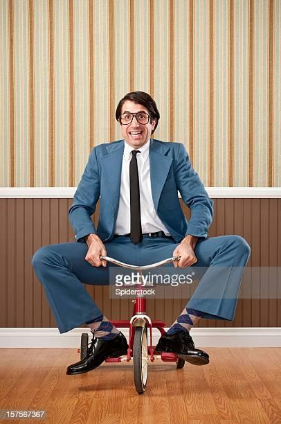 Naiv Geschäftsmann Riding Dreirad