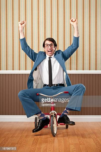 nerdy businessman riding tricycle - hands free cycling stock pictures, royalty-free photos & images