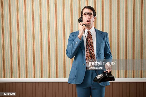 nerdy businessmanspeaking on vintage telephone - striped suit stock pictures, royalty-free photos & images